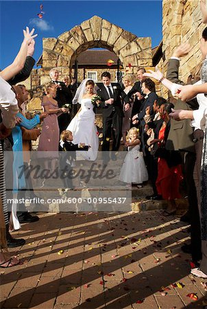 Newlyweds Leaving Church Stock Photo - Premium Royalty-Free, Image code: 600-00955437