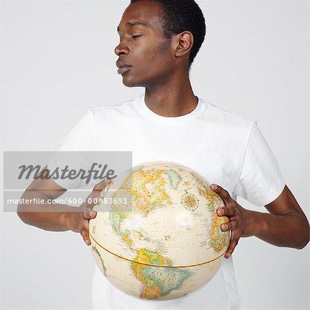 Portrait of Man Holding Globe