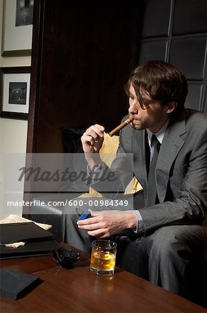 Man with Cigar and Liquor Stock Photo - Premium Royalty-Free, Image code: 600-00984349