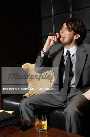 Man with Cigar and Liquor Stock Photo - Premium Royalty-Free, Image code: 600-00984350