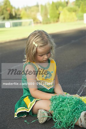 Girl Dressed as Cheerleader Stock Photo - Premium Royalty-Free, Image code: 600-01015105