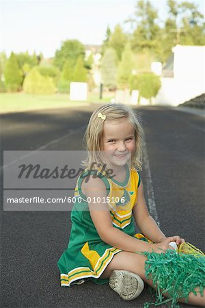 Girl Dressed as Cheerleader Stock Photo - Premium Royalty-Free, Image code: 600-01015106