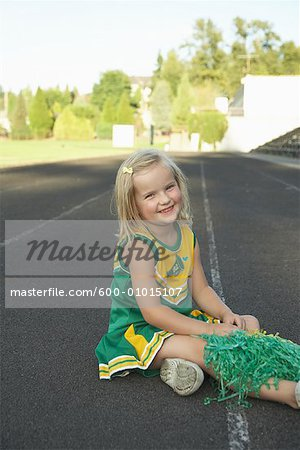 Girl Dressed as Cheerleader Stock Photo - Premium Royalty-Free, Image code: 600-01015107