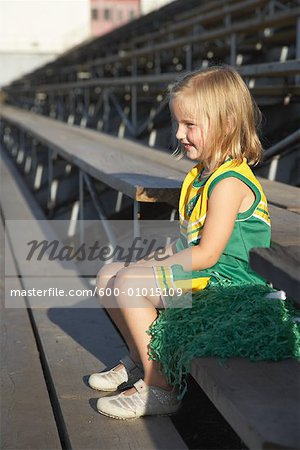 Girl Dressed as Cheerleader in Bleachers Stock Photo - Premium Royalty-Free, Image code: 600-01015109