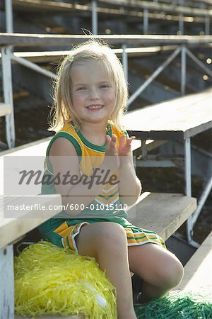 Girl Dressed as Cheerleader in Bleachers Stock Photo - Premium Royalty-Free, Image code: 600-01015110