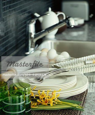 Dishes Stacked Beside Kitchen Sink Stock Photo - Premium Royalty-Free, Image code: 600-01015276