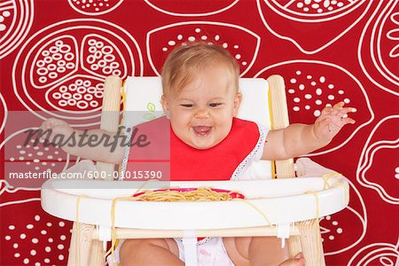 Baby with Spaghetti in High Chair Stock Photo - Premium Royalty-Free, Image code: 600-01015390