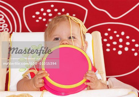 Baby with Spaghetti in High Chair Stock Photo - Premium Royalty-Free, Image code: 600-01015394