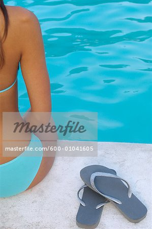 Woman at Side of Pool Stock Photo - Premium Royalty-Free, Image code: 600-01041605