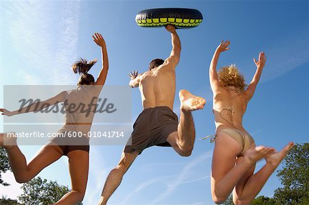 People Jumping in Swimming Pool Stock Photo - Premium Royalty-Free, Image code: 600-01041714