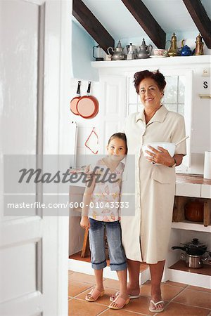 Grandmother and Granddaughter in Kitchen Stock Photo - Premium Royalty-Free, Image code: 600-01043333