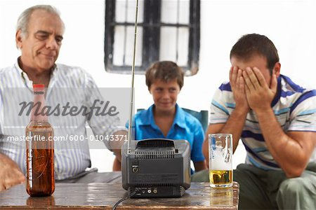 Grandfather, Father and Son Watching Television in Backyard Stock Photo - Premium Royalty-Free, Image code: 600-01043371