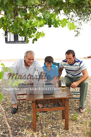 Grandfather, Father and Son Watching Television in Backyard Stock Photo - Premium Royalty-Free, Image code: 600-01043372