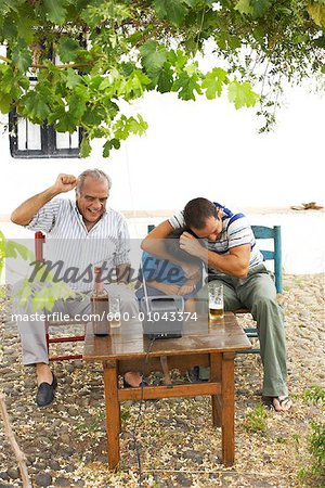 Grandfather, Father and Son Watching Television in Backyard Stock Photo - Premium Royalty-Free, Image code: 600-01043374