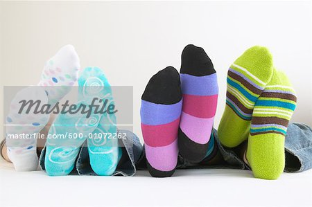 Row of Feet with Colorful Socks Stock Photo - Premium Royalty-Free, Image code: 600-01072262