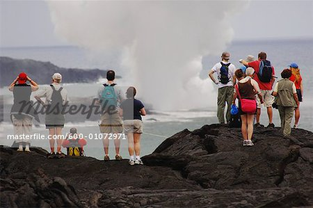 Tourists Standing on Lava, Looking at the Ocean, Hawaii, USA Stock Photo - Premium Royalty-Free, Image code: 600-01072971