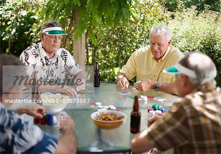 Men Playing Cards Outdoors Stock Photo - Premium Royalty-Free, Image code: 600-01073507