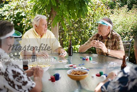 Men Playing Cards Outdoors Stock Photo - Premium Royalty-Free, Image code: 600-01073508