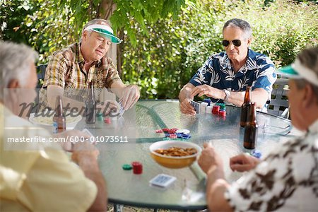 Men Playing Cards Outdoors Stock Photo - Premium Royalty-Free, Image code: 600-01073511