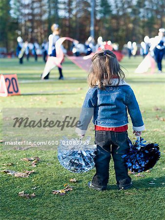Little Girl Cheerleading Stock Photo - Premium Royalty-Free, Image code: 600-01083793
