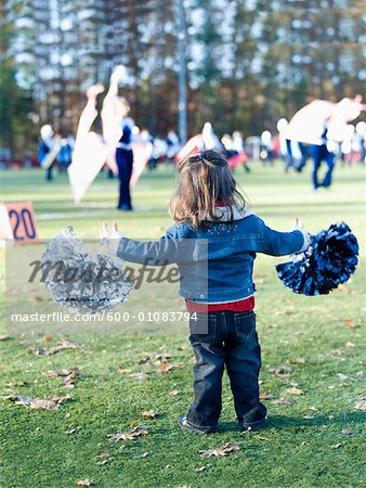 Little Girl Cheerleading Stock Photo - Premium Royalty-Free, Image code: 600-01083794