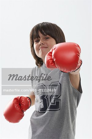 Portrait of Boy Wearing Boxing Gloves Stock Photo - Premium Royalty-Free, Image code: 600-01112023