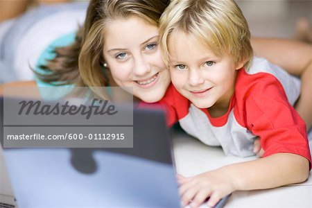 Girl and Boy Using Laptop Computer Stock Photo - Premium Royalty-Free, Image code: 600-01112915