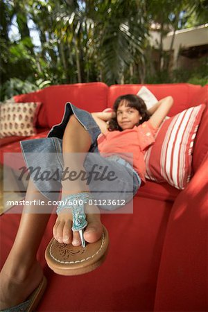 Portrait of Girl Lying on Sofa Stock Photo - Premium Royalty-Free, Image code: 600-01123612