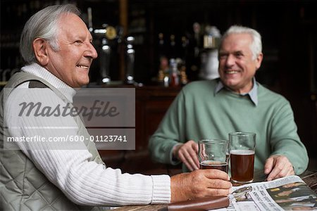 Friends in Pub Stock Photo - Premium Royalty-Free, Image code: 600-01123741