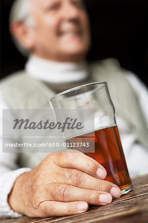 Man Holding Beer Stock Photo - Premium Royalty-Free, Image code: 600-01123743