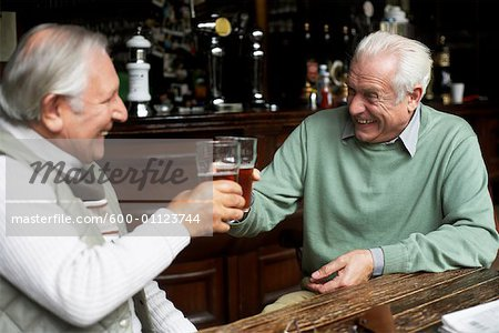 Friends Drinking Beer in Pub Stock Photo - Premium Royalty-Free, Image code: 600-01123744