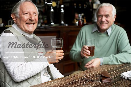 Friends in Pub Stock Photo - Premium Royalty-Free, Image code: 600-01123745