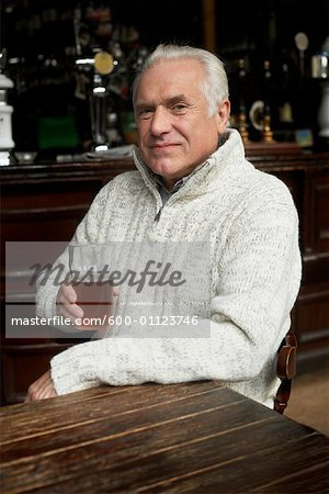 Man Drinking Beer in Pub Stock Photo - Premium Royalty-Free, Image code: 600-01123746