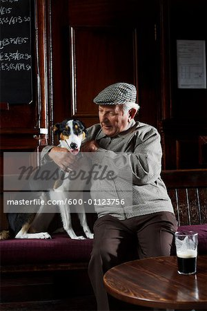 Man With Dog in Pub Stock Photo - Premium Royalty-Free, Image code: 600-01123756