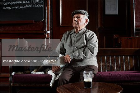 Man With Dog in Pub Stock Photo - Premium Royalty-Free, Image code: 600-01123757
