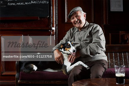 Man With Dog in Pub Stock Photo - Premium Royalty-Free, Image code: 600-01123758