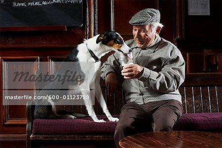 Man With Dog in Pub Stock Photo - Premium Royalty-Free, Image code: 600-01123759
