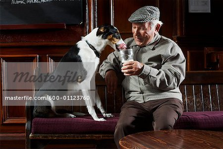 Man With Dog in Pub Stock Photo - Premium Royalty-Free, Image code: 600-01123760