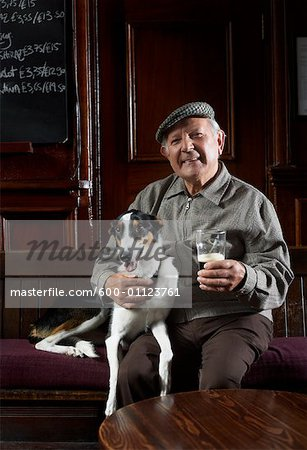 Man With Dog in Pub Stock Photo - Premium Royalty-Free, Image code: 600-01123761