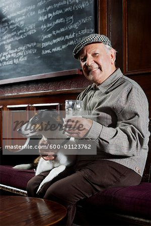 Man With Dog in Pub Stock Photo - Premium Royalty-Free, Image code: 600-01123762