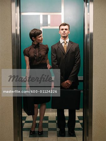Business People In Elevator
