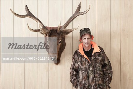 Portrait of Hunter Stock Photo - Premium Royalty-Free, Image code: 600-01124343