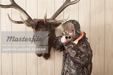 Hunter Aiming Shotgun Stock Photo - Premium Royalty-Free, Image code: 600-01124346