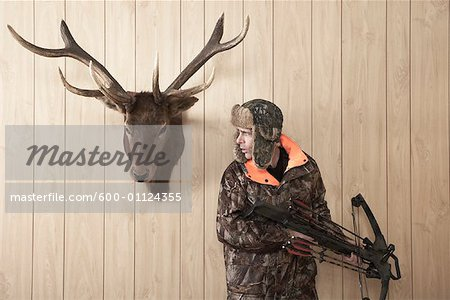 Hunter with Crossbow Stock Photo - Premium Royalty-Free, Image code: 600-01124355