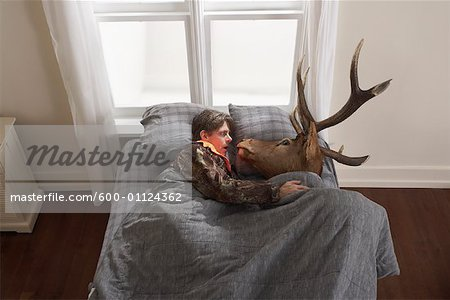Hunter Sleeping with Deer Head Stock Photo - Premium Royalty-Free, Image code: 600-01124362