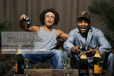 Friends Playing Video Game Stock Photo - Premium Royalty-Free, Image code: 600-01124699