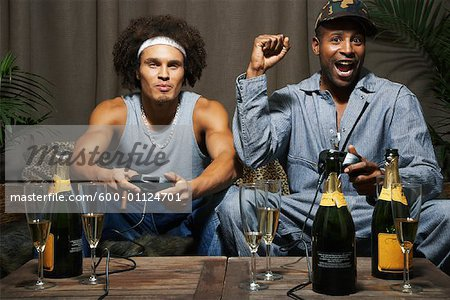 Friends Playing Video Game Stock Photo - Premium Royalty-Free, Image code: 600-01124701