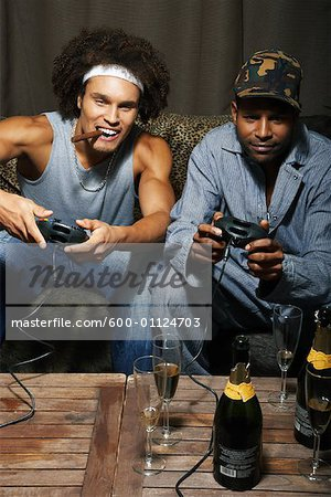 Friends Playing Video Game Stock Photo - Premium Royalty-Free, Image code: 600-01124703