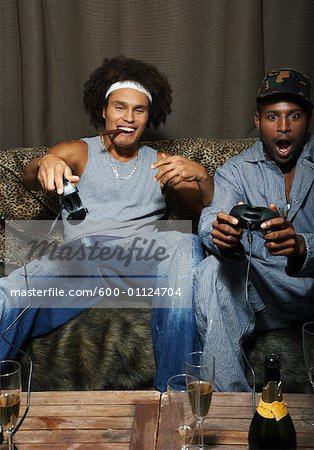 Friends Playing Video Game Stock Photo - Premium Royalty-Free, Image code: 600-01124704