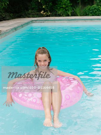 Girl in Swimming Pool Stock Photo - Premium Royalty-Free, Image code: 600-01164458